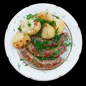 Grilled sausages and potatoes, isolated with clipping path