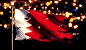 stock photo of bahrain  - Bahrain National Flag Torn Burned War Freedom Night 3D - JPG