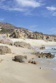 sand rock and beach