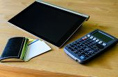 Workplace With Tablet Pc, Calculator And Bussiness Card