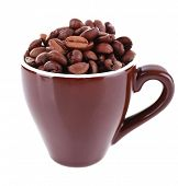 Mug of coffee beans isolated on white