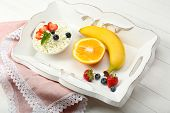 Delicious breakfast with cottage cheese and fruits