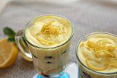 Tasty lemon desserts on table at home