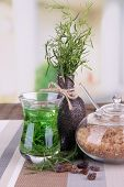 Estragon drink on wooden table on bright background