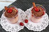Tasty cherry dessert on table