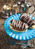 pic of eclairs  - Chocolate Eclairs And Cup Of Espresso on the table - JPG