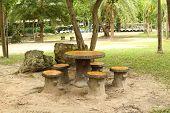 cement garden chair in beautiful garden