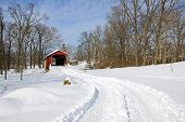 stock photo of covered bridge  - Pool Forge Covered Bridge with snow in Lancaster County - JPG