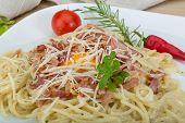 image of carbonara  - Pasta Carbonara with tomato rosemary and basil leaves - JPG