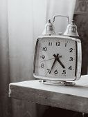 Black And White Retro Alarm Clock With Bells On The Table