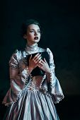 foto of dungeon  - Woman in victorian dress imprisoned in a dungeon - JPG