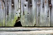 Mouse Hole In An Old Barn Door