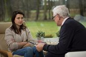Girl Talking With Elder Psychiatrist