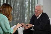 Elderly Patient Talking With Psychotherapist