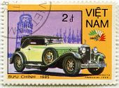 VIETNAM - CIRCA 1985: A stamp printed in Vietnam shows a car Isotta Fraschini 1928 and Leaning Tower of Pisa, series