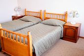 stock photo of motel  - bed in motel room  - JPG