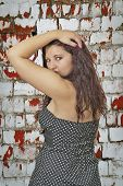 picture of wench  - View portrait of young girl in front of a brick wall - JPG