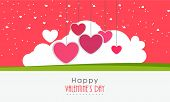 Happy Valentine's Day celebration beautiful greeting card decorated by hanging pink heart and cloud.