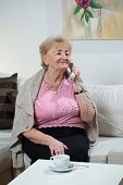 Woman Talking On Landline Phone