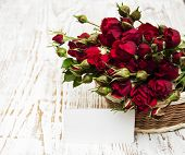 Red Roses In Basket And Greeting Card