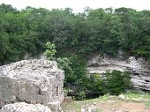 stock photo of cenote  - Sacred cenote view at Chichen Itza - JPG