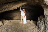 picture of cave woman  - portrait of a young couple in love inside a cave of a greek island - JPG
