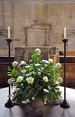 Church Flower Arrangement By The Christening Font