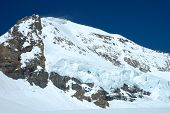 stock photo of firn  - Snow and ice on Monch mountainside nearby Jungfraujoch in Alps in Switzerland - JPG