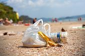 Garbage On A Beach, Environmental Pollution Concept Picture.