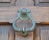 Doorknocker on wooden frontdoor.