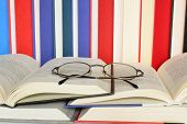 Eyeglasses on Open Books