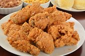 picture of fried chicken  - A plate of fried chicken with side dishes - JPG