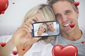 Composite image of valentines couple taking a selfie