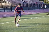 Young Man Playing Soccer