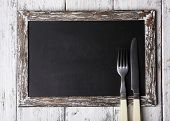 Menu board on color wooden planks background