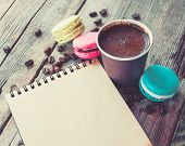 picture of sketch book  - Macaroons cookies espresso coffee cup and sketch book on wooden rustic table vintage stylized photo