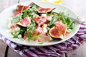 foto of rocket salad  - Rocket feta fig and prosciutto salad on plate - JPG