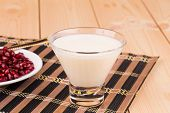 Milk with grains of pomegranate