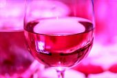 Glass Of Red Wine As On Pink Picture