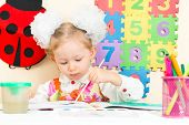 Cute Child Girl Drawing With Colorful Pencils In Preschool At Table In Kindergarten