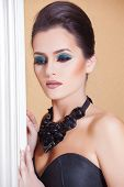Gorgeous Fashion Model in Ceremonial Shiny Dress with beautiful make-up