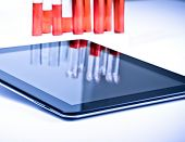 Modern Digital Tablet Pc Near Test Tube In Laboratory