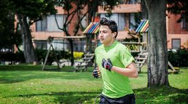 picture of track home  - Young man at a local park jogging near home - JPG