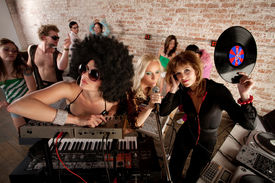 stock photo of lps  - Cool female DJs performing at a 1970s Disco Music Party - JPG