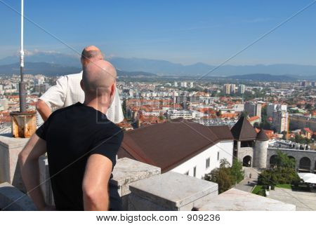 poster of Turists Looking Down On Main City