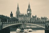 stock photo of westminster bridge  - Westminster Palace and bridge over Thames River in London in black and white - JPG
