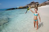 stock photo of preteens  - Preteen child posing with snorkeling equipment on a tropical beach - JPG