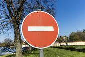 picture of no entry  - No entry for vehicles traffic sign against blue sky - JPG