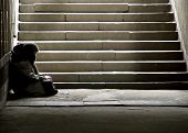 stock photo of underpass  - homeless woman reading a book in pedestrian underpass - JPG