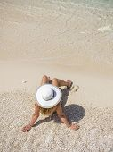 image of shipwreck  - Woman relaxing on the famous Shipwreck Navagio beach in Zakynthos Greece - JPG